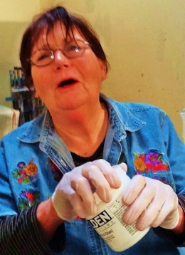 Artist Judith Toller pleading for my man hands to open her jar.